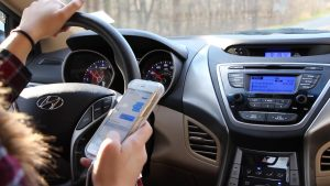 Stay safe and keep your insurance rates low by avoiding distracted driving.